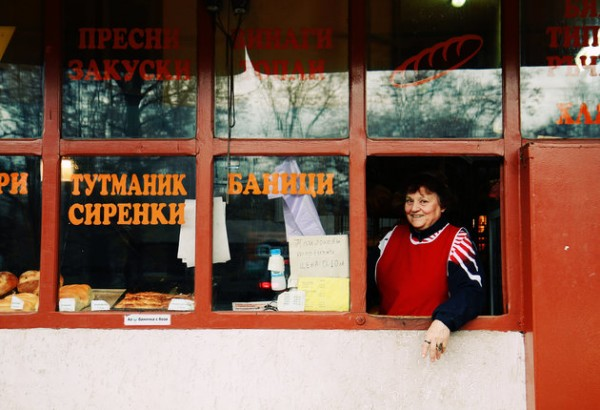 [UNVERIFIED CONTENT] 29 November 2012: shop-keeper at a small bakery in downtown Sofia, Bulgaria, inviting customers with a smile