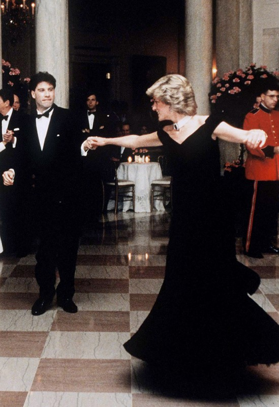 WASHINGTON - NOVEMBER 9: Princess Diana, Princess of Wales, wearing an evening dress designed by Victor Edelstein, dances with movie star John Travolta at the White House during her visit to America on November 9, 1985 in Washington DC, U.S.A. (Photo by Anwar Hussein/Getty Images)