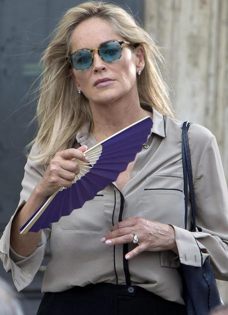 Sharon Stone gets ready to shoot a scene during the filming of the movie 'Il ragazzo d'oro' (The golden boy) in Rome, Italy, 18 July 2013 on the first day of shooting of the new movie of Italian director Pupi Avati. ANSA/MASSIMO PERCOSSI