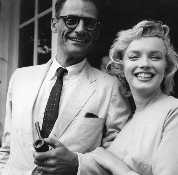 American film star Marilyn Monroe (1926 - 1962) outside her home in Englefield Green with her third husband American playwright Arthur Miller. Original Publication: People Disc - HN0485 (Photo by Evening Standard/Getty Images)